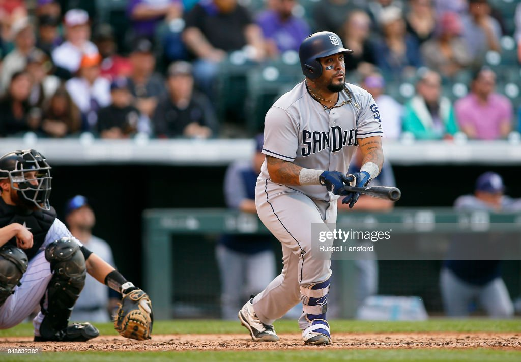 Hector Sanchez #44 of the San Diego Padres singles for a two RBI base hit to tie the in the eighth inning of a regular season MLB game between the Colorado Rockies and the visiting San Diego Padres at Coors Field on September 17, 2017 in Denver, Colorado.