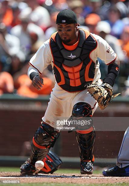 Hector Sanchez of the San Francisco Giants chases a wild pitch against the New York Mets during the game at ATT Park on Sunday June 8 2014 in San...