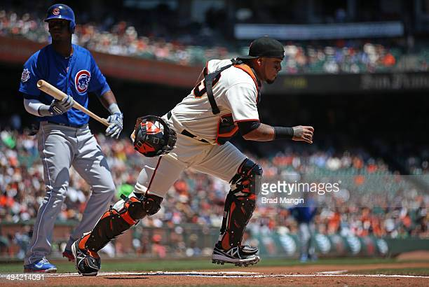 Hector Sanchez of the San Francisco Giants chases a wild pitch against the Chicago Cubs during the game at ATT Park on Wednesday May 28 2014 in San...