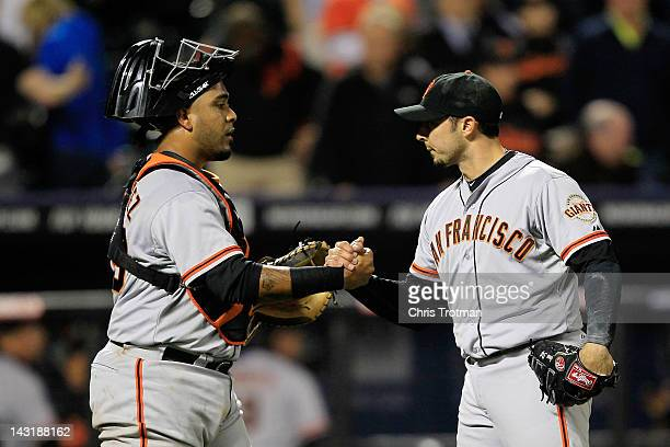 Hector Sanchez of the San Francisco Giants congratulates his teammate the winning pitcher Clay Hensley of the San Francisco Giants after defeating...