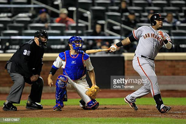 Hector Sanchez of the San Francisco Giants hits a two run homer in the seventh inning against the New York Mets at Citi Field on April 23 2012 in the...