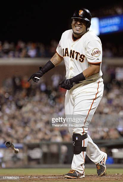 Hector Sanchez of the San Francisco Giants reacts in pain after he was hit with a pitch by pitcher Brayan Villarreal of the Boston Red Sox in the...