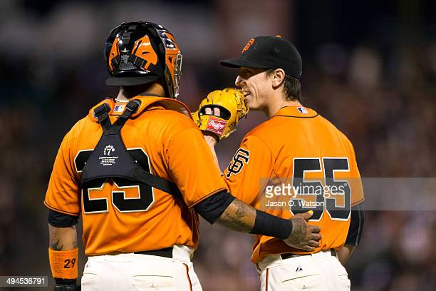 Hector Sanchez of the San Francisco Giants talks to Tim Lincecum at the pitchers mound against the Minnesota Twins during the fifth inning at ATT...