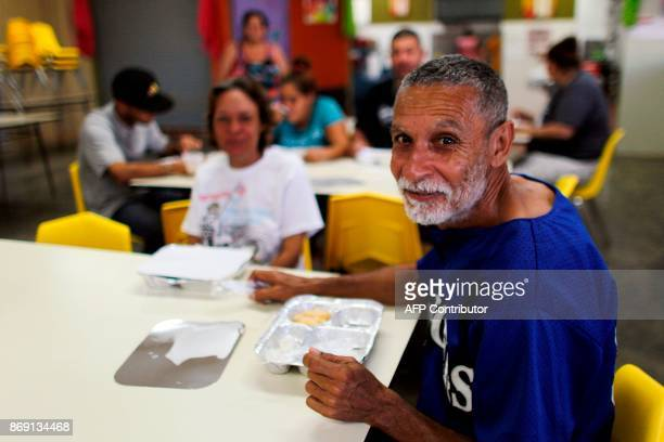 Hector Santana takes breakfast at the school canteen in Barranquitas Puerto Rico October 31 2017 Twenty people from Barranquitas have been living for...