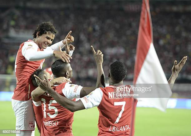 Hector Urrego of Santa Fe celebrates with teammates after scoring the first goal of his team during a second leg final match between Santa Fe and...