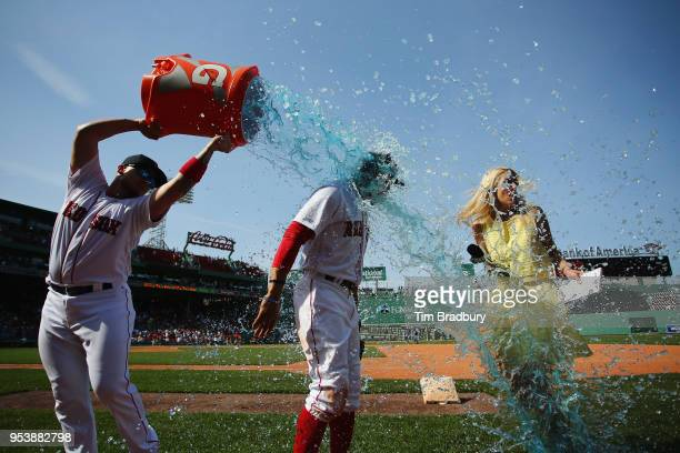 Hector Velazquez of the Boston Red Sox douses Mookie Betts as he is interviewed after the Boston Red Sox defeated the Kansas City Royals 54 at Fenway...