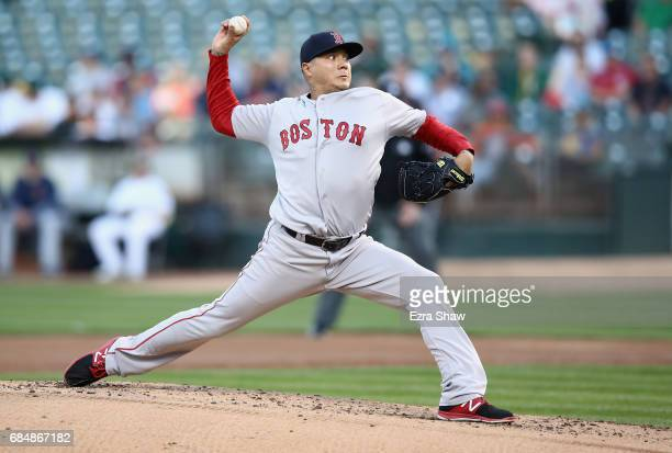 Hector Velazquez of the Boston Red Sox makes his first pitch during his Major League Baseball debut against the Oakland Athletics at Oakland Alameda...