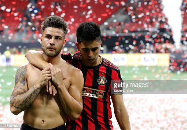 Hector Villalba and Pity Martinez of Atlanta United react after their 2-1 loss to Toronto FC in the Eastern Conference Finals between Atlanta United...