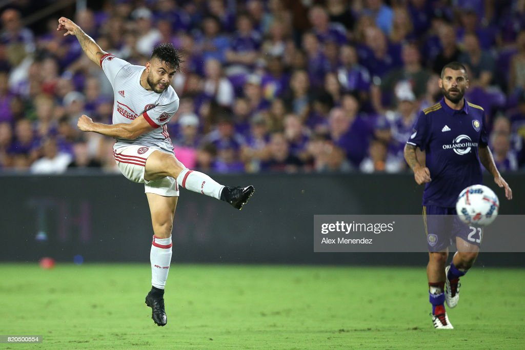 Hector Villalba #15 of Atlanta United scores a goal in front of Antonio Nocerino #23 of Orlando City SC during a MLS soccer match between Atlanta United FC and the Orlando City SC at Orlando City Stadium on July 21, 2017 in Orlando, Florida.