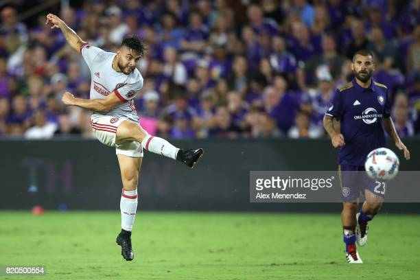 Hector Villalba of Atlanta United scores a goal in front of Antonio Nocerino of Orlando City SC during a MLS soccer match between Atlanta United FC...