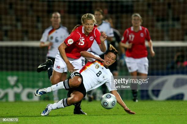 Hedda Gardsjord of Norway challenges Inka Grings of Germany during the UEFA Women's Euro 2009 SemiFinal match between Germany and Norway at the...