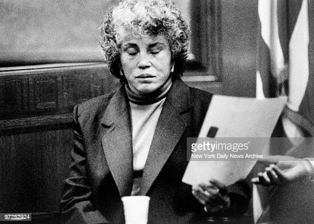 Hedda Nussbaum cries in court as she identifies a photo of Lisa Steinberg prior to her death