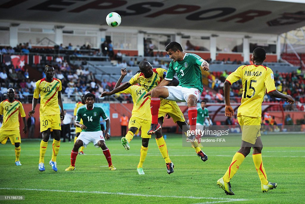 Hedgardo Marin of Mexico wins a header from Boubacar Diarra of Mali during the FIFA U20 World Cup Group D match between Mali and Mexico at Kamil Ocak Stadium on June 28, 2013 in Gaziantep, Turkey.