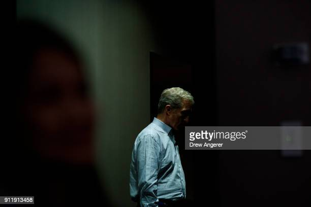 Hedge fund billionaire and Democratic fundraiser Tom Steyer waits backstage before a town hall event at the DoubleTree Suites by Hilton hotel in...