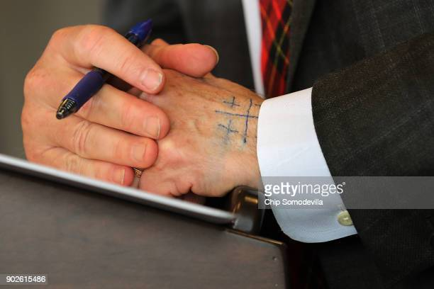 Hedge fund billionaire Democratic megadonor and environmentalist Tom Steyer has a Jerusalem Cross written in blue ink on the back of his hand during...