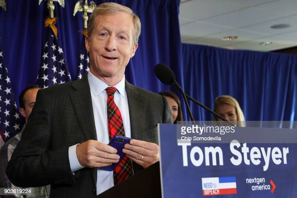 Hedge fund billionaire Democratic megadonor and environmentalist Tom Steyer silences his mobile device during a news conference regarding his...