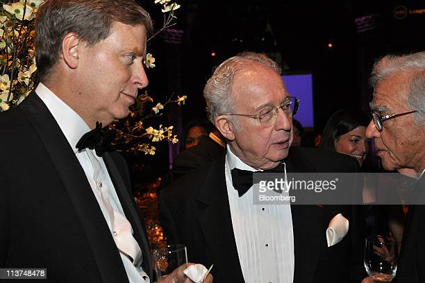 Hedge fund manager Stanley Druckenmiller left speaks with Martin Lipton chairman of the board of trustees for New York University center at the...