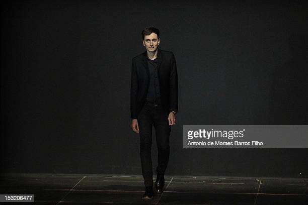 Hedi Slimane walks the runway during the Saint Laurent Spring / Summer 2013 show as part of Paris Fashion Week on October 1 2012 in Paris France