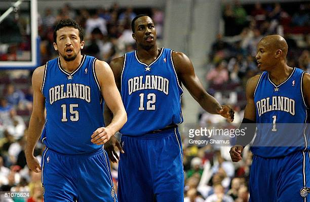 Hedo Turkoglu Dwight Howard and Maurice Evans of the Orlando Magic walk towards the bench against the Detroit Pistons in Game Five of the Eastern...