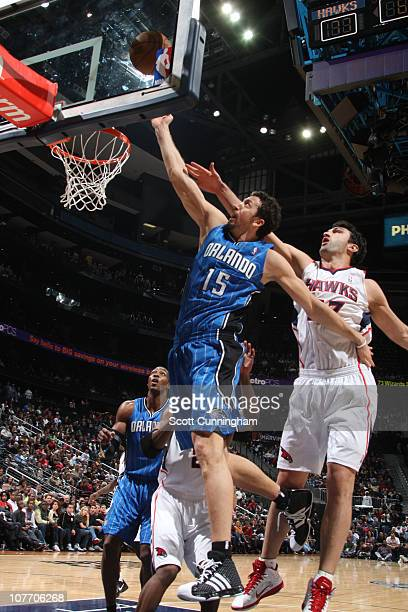 Hedo Turkoglu of the Orlando Magic shoots against Zaza Pachulia of the Atlanta Hawks on December 20 2010 at Philips Arena in Atlanta Georgia NOTE TO...