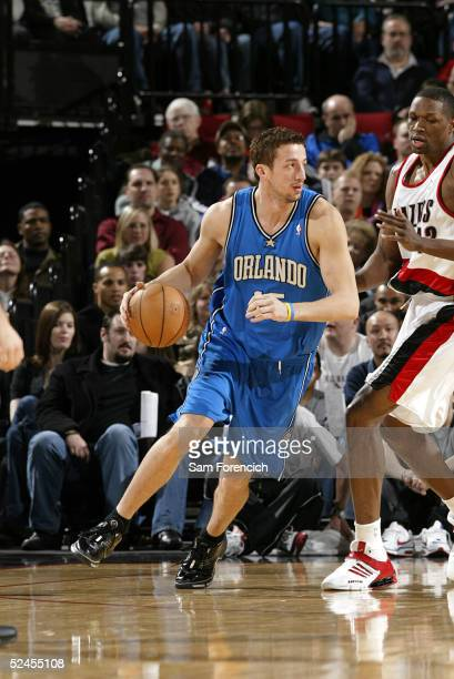 Hedo Turkoglu of the Orlando Magic takes the ball around Theo Ratliff of the Portland Trail Blazers on March 19 2005 at the Rose Garden Arena in...