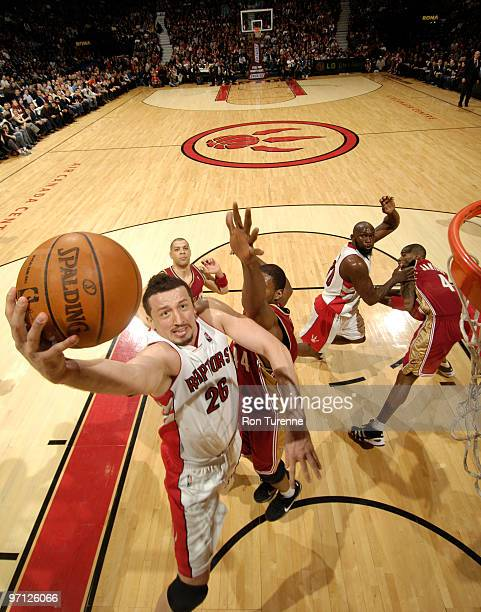 Hedo Turkoglu of the Toronto Raptors drives hard to the basket and tries the layup past Leon Powe of the Cleveland Cavaliers on February 26 2010 at...
