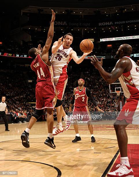 Hedo Turkoglu of the Toronto Raptors finds the open man in the paint passing around Leon Powe of the Cleveland Cavaliers on February 26 2010 at the...