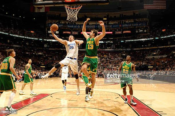 Hedo Turkoglu of the Toronto Raptors glides for the layup defended by Mehmet Okur of the Utah Jazz during a game on March 24 2010 at the Air Canada...