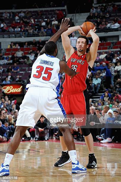 Hedo Turkoglu of the Toronto Raptors looks for an open pass over DaJuan Summers of the Detroit Pistons during the game on December 23 2009 at The...