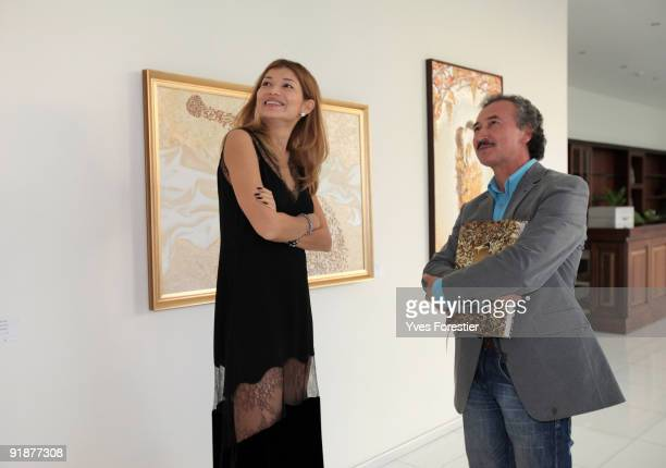 DrGulnara Karimova Chairwoman of the Board of Trustees and FundForum Painter Akmal Nur attend the Akmal Nur Exhibition opening at The Center of...