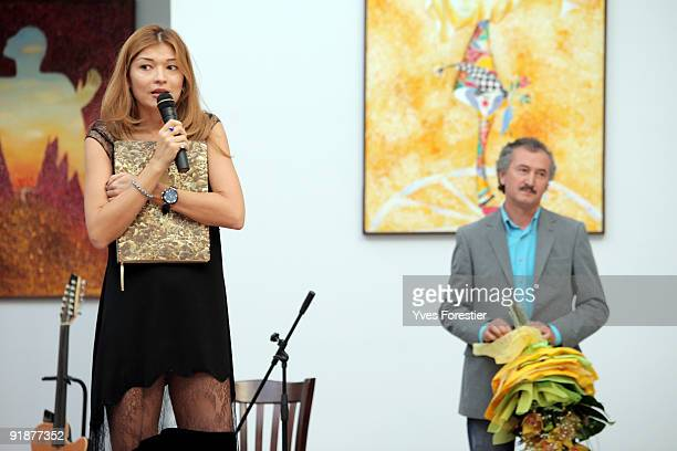 DrGulnara Karimova Chairwoman of the Board of Trustees makes a speech as FundForum Painter Akmal Nur looks on during the Akmal Nur Exhibition opening...