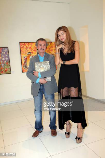 HEDrGulnara Karimova chairwoman of the Board of Trusteesfund ForumPainter Akmal Nur visiting the Akmal Nur Exhibition opening at The Center of...