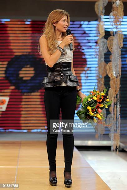DrGulnara Karimova chairwoman of the Board of Trusteesfund makes a speech during the Underground fashion show by young Uzbec and foreign designers on...