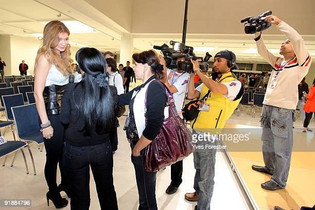 DrGulnara Karimova chairwoman of the Board of Trusteesfund makes an interview during the Underground fashion show by young Uzbec and foreign...