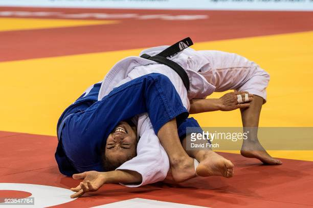 Hedvig Karakas of Hungary holds Miryam Roper of Panama for an ippon to reach the u57kg semi-final and eventually the silver medal during the 2018...
