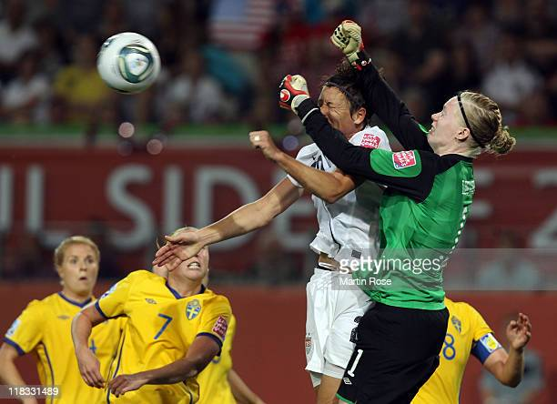 Hedvig Lindahl goalkeeper of Sweden and Abby Wambach of USA battle for the ball during the FIFA Women's World Cup 2011 Group C match between Sweden...