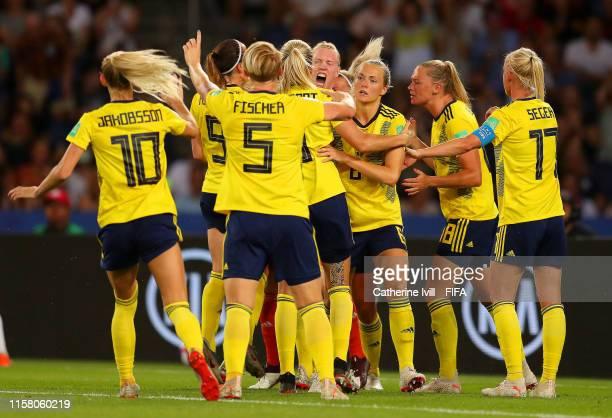 Hedvig Lindahl of Sweden celebrates with teammates after saving a penalty during the 2019 FIFA Women's World Cup France Round Of 16 match between...