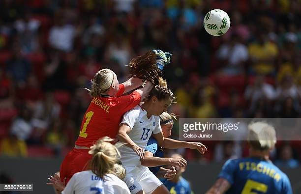 Hedvig Lindahl of Sweden collides with Alex Morgan of United States during the first half of the Women's Football Quarterfinal match at Mane...
