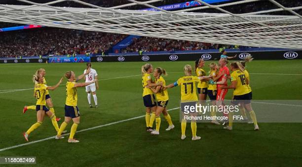 Hedvig Lindahl of Sweden is congratulated after saving a penalty from Janine Beckie of Canada during the 2019 FIFA Women's World Cup France Round Of...