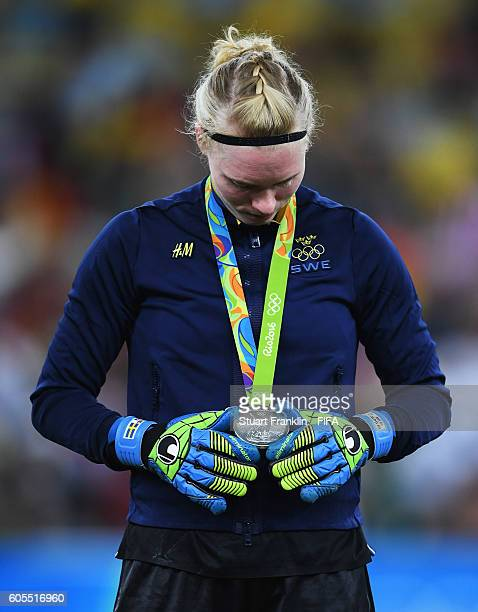Hedvig Lindahl of Sweden looks at her silver medal during the Olympic Women's Football final between Sweden and Germany at Maracana Stadium on August...