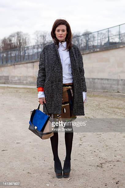 Hedvig Opshaug blogger wearing a Balenciaga bracelet and skirt her boyfriends shirt Celine bag Isabel Marant coat and Acne shoes at Paris Fashion...