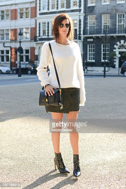 Hedvig Opshaug, model and fashion blogger, wearing and Acne jumper and skirt, Phillip Lim shoes, Proenza Schouler bag and Tom Ford sunglasses on day...