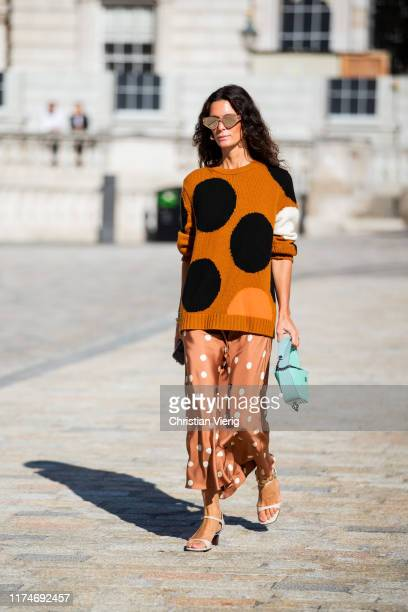 Hedvig Sagfjord Opshaug is seen wearing orange black knit with dots print and dress, turqouis bag outside Fyodor Golan during London Fashion Week...