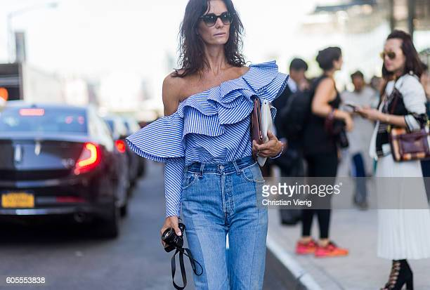 Hedvig Sagfjord Opshaug wearig a blue blouse and denim jeans outside Tory Burch on September 13 2016 in New York City