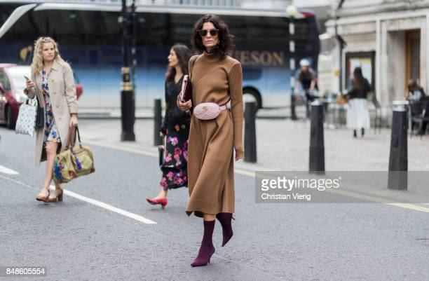 Hedvig Sagfjord Opshaug wearing pink Gucci belt bag brown dress sock boots outside Preen during London Fashion Week September 2017 on September 17...