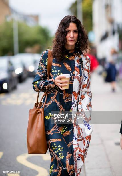 Hedvig Sagfjord Opshaug wearing two tone dress with print brown leather bag white ankle boots is seen outside Natasha Zinko during London Fashion...