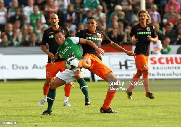 Hedwiges Maduro of Valencia and Mesut Oezil of Bremen compete for the ball during the pre season friendly match between FC Valencia and SV Werder...
