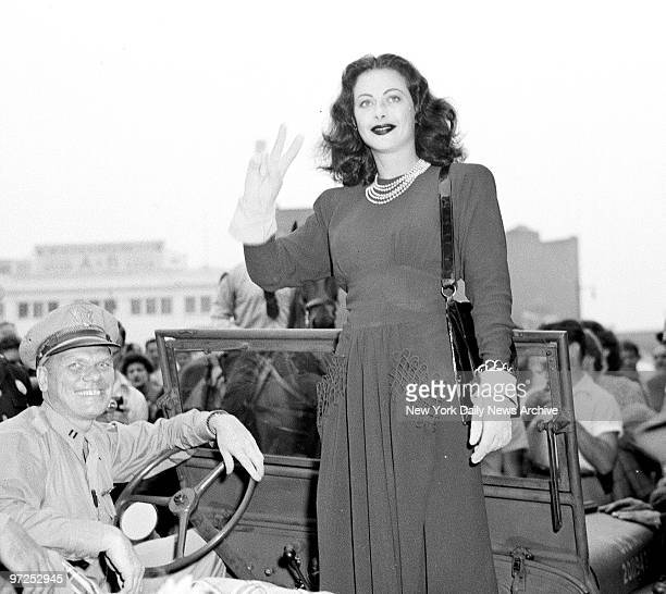 Hedy Lamarr gives the VforVictory sign while selling war bonds in Newark NJ
