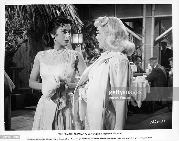 Hedy Lamarr looking over at Jan Sterling in a scene from the film 'The Female Animal' 1958
