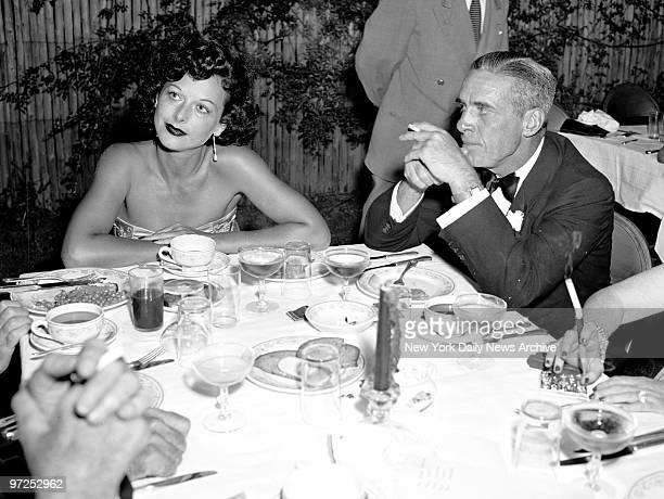 Hedy Lamarr minus jewels and Walcott Blair as they dined at Southampton
